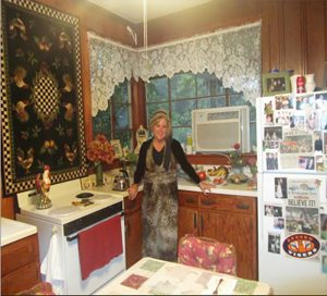 Dedra standing in her grandmother's kitchen.